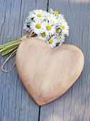 foto of marriage proposal  - Wooden heart and a bouquet of daisies - JPG