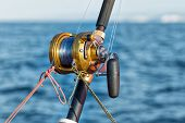 foto of game-fish  - fishing reel and pole in boat during big game - JPG