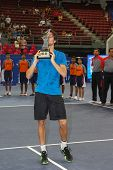 KUALA LUMPUR - SEPTEMBER 29: Winner Joao Souso (portugal) kisses the singles champion trophy of the Malaysian Open 2013 in Putra Stadium, Malaysia on September 29, 2013. He defeated Julien Benneteau.