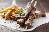 meat skewer with herbs, lime and pita bread