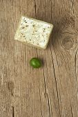 Handmade Olive Soap With A Green Olive On Wooden Table.