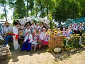 SUMY, UKRAINE - AUGUST 17: Women wearing historical costume posing in traditional village background