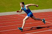 picture of sprinter  - Sprinter leaving starting blocks on running track - JPG