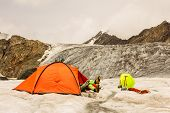The Climber Has A Rest Lying In Tent On Glacier
