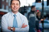 Confident Businessman Posing, Street Background