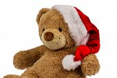 a teddy bear with gifts for christmas. dressed as santa claus.