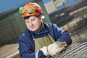 adult industrial female worker spot welder in factory workshop