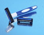 Men shaver on light blue background