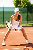 Focused young female tennis player on tennis court