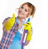 Spring cleaning woman pointing cleaning spray bottle.