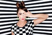 Beautiful  young woman  on stripy background, beauty and fashion concept