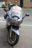 Sign on booted by the City of New York illegally parked motorcycle in Manhattan