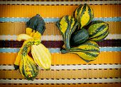 Ornamental Gourds On The Striped Tablecloth