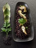 risotto with black rice and artichoke