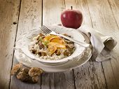 Risotto with apple and cep edible mushroom