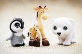 Three Plastic Toy Figurines