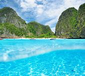 Beautiful lagoon at  Phi Phi Ley island with white sand bottom underwater and above water split view