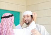 Gulf Arabic Muslim people posing