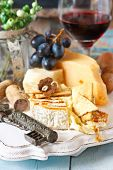 foto of fruit platter  - Still life with delicious cheese red wine fruits and nuts - JPG