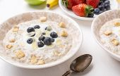 stock photo of porridge  - Creamy Porridge with Yogurt - JPG