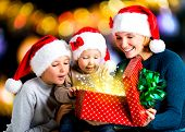 Mother With Children Opens The Box With Gifts On The Christmas Holiday