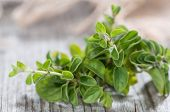 stock photo of oregano  - Oregano Plant on wood on grey vintage wooden background