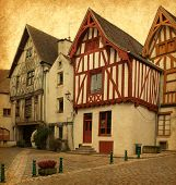 Ancient architecture of Noyers, Burgundy, France. Photo in retro style. Added paper texture.