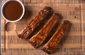Ribs On A Cutting Board With Bbq Sauce