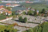 Friedhof (cemetery, graveyard) surrounded by Apple Orchard in Trentino-Alto Adige, Italy