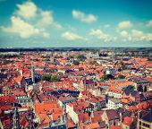 Vintage retro hipster style travel image of aerial view of Bruges (Brugge) from Belfry, Belgium with