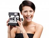 Lady takes pictures with cassette photographic camera, isolated on white