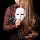 Fashion Man Holding A White Mask Face. Psychological Concept. Duality Look At Relationships.