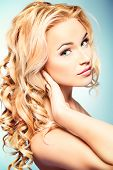 Portrait of a smiling woman with beautiful blonde hair. Hair care. Beauty, fashion.