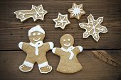 stock photo of ginger bread  - A Happy Ginger Bread Couple with Stars and a Falling Star Symbolizing Romance Christmas and Love - JPG