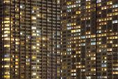Close - up of a modern high condominium at night time