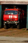 NIZHNY NOVGOROD. RUSSIA. JULY 31, 2014. STRIGINO AIRPORT.the fire truck leaves a hangar