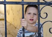 Child Behind A Gate Or Fence