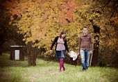 Family relaxing together in autumn nature