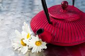 Natural Chamomile Tea In A Teapot With Flowers