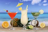 image of pina-colada  - Cocktails and drinks like Pina Colada and Martini on the beach and sea - JPG