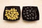 pic of marinade  - Marinaded olives in a black square plate - JPG
