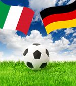 Football Field And National Flags Of Germany And Italy
