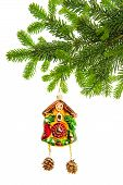 Christmas Decoration With Clock Bauble And Evergreen Tree Branch
