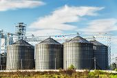 picture of silo  - Cereal silos under the blue sky and clouds - JPG