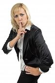 Business woman holding her finger near the mouth