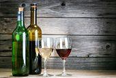 bottle of vine on  wooden background
