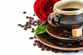 Cup Of Black Coffee And Red Rose Flower Over White Background