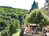 Tourists In Castle Eltz Above Mosel River, Germany