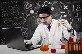 Asian Scientist Working In Laboratory