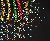 Colorful Streamer And Confetti On Black Paper
